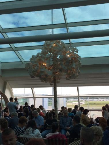 london luton airport, departures, seating, crowd, london luton airport